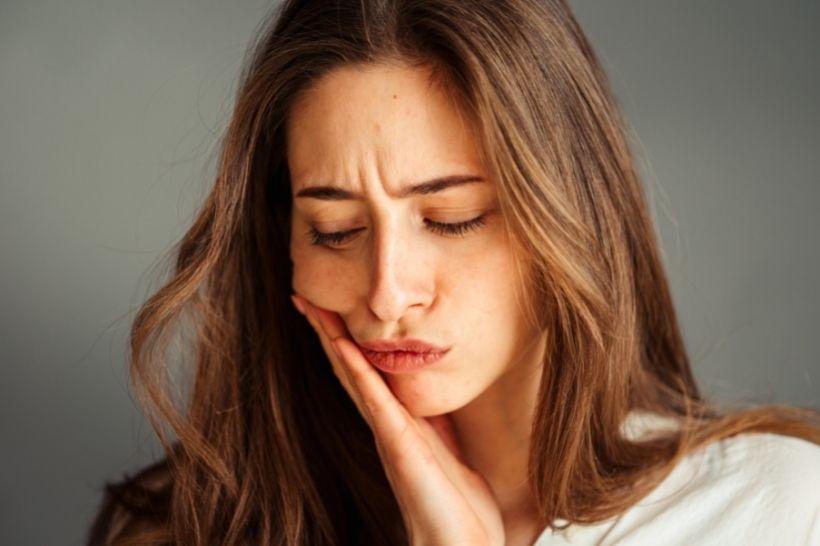 Dente do siso nascendo: como diminuir a dor?